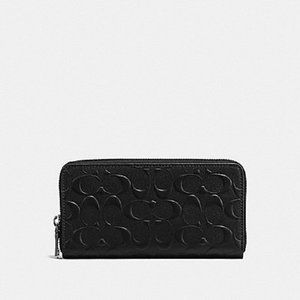 Coach long wallet zip round leather in signature